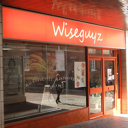 Wiseguyz illuminated sign